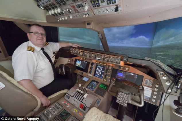 Amazing: John Davis has spent 15 years building a life-sized Boeing 747-400 replica cockpit in his bedroom