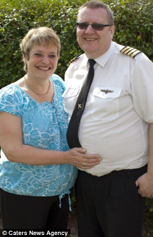 Couple: Mr Davis , pictured with his partner, Allyson Mabey, charges £75 for an hour-long flight