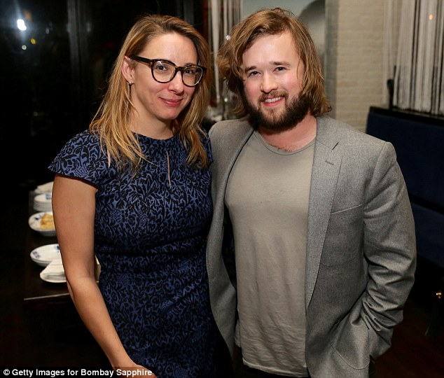 Sight for the senses: The Sixth Sense star, who is now 26, had that cool New York actor look in dress jacket and rumpled T-shirt as he posed with producer Jennifer Glynn