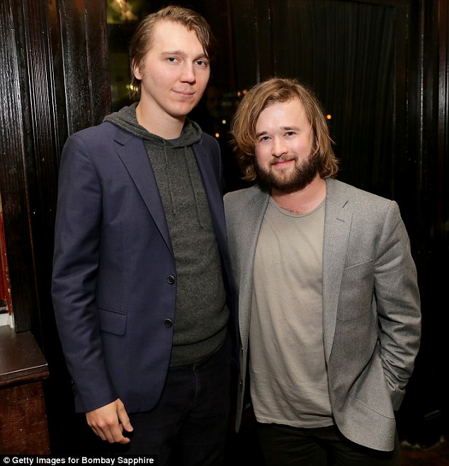 Bearded approach: Haley Joel Osment covered up his dewy, youthful looks with facial fringe as he hit up the premiere after-party for In Your Eyes in New York on Sunday; here he's pictured with actor Paul Dano