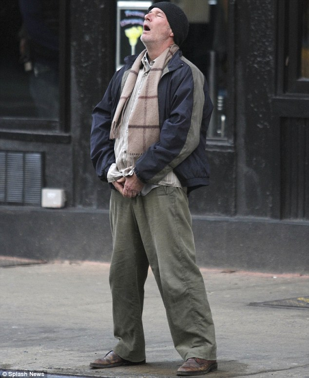 Not his dapper self: Richard appeared to relieve himself in character on the set of Time Out of Mind in Manhattan last week