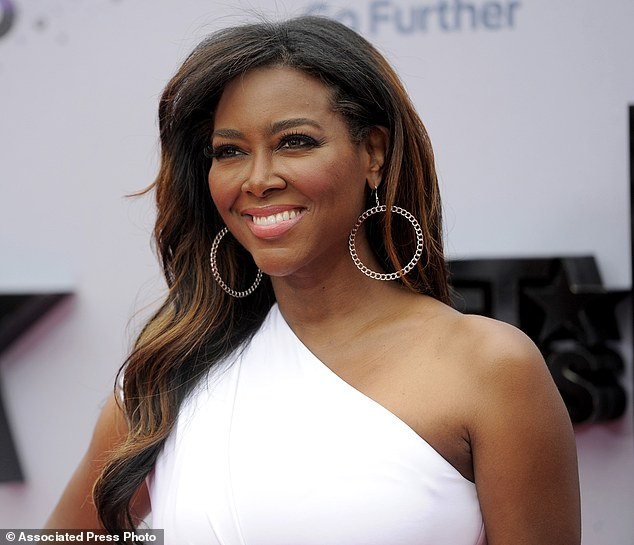 No more drama? Kenya Moore has revealed that she is seriously considering leaving The Real Housewives Of Atlanta following her brawl with Porsha Williams