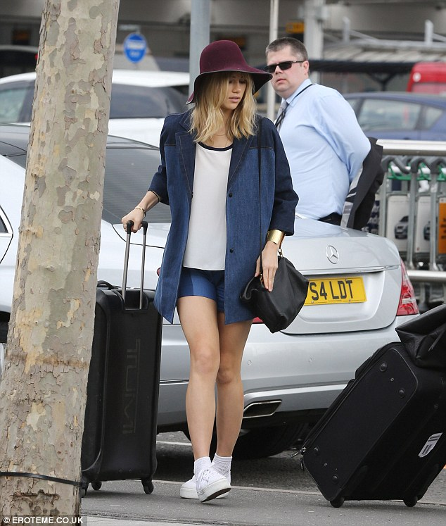 She's got the legs for it: Suki Waterhouse shows off her slim pins in a Tommy Hilfiger denim jacket and matching shorts