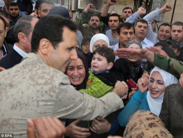 Syrian president Bashar Assad (left) during his visit to the predominanetly Christian city of Maaloula city, Syria