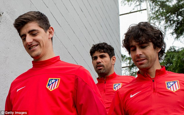 Fitted in: Courtois with Diego Costa (centre) and Arda Turan (right)