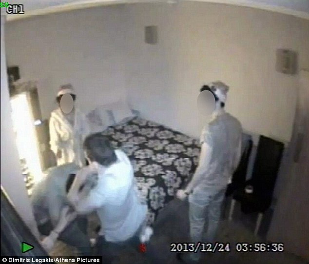 Attack: Bantick, bottom of the picture, was captured on CCTV assaulting a person at the massage parlour on Swansea high street. He had gone to the parlour with his brother wearing a Christmas Santa hat
