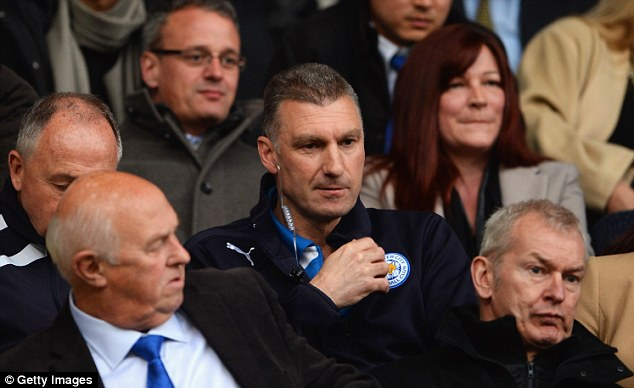 Wired up: Leicester boss Nigel Pearson gives directions to the bench from the stands