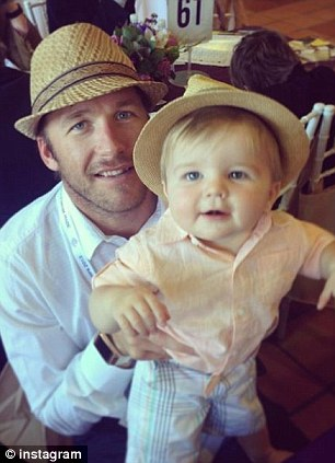 Father: Bode Miller with his 14-month-old son - who will be shared between him and the boy's mother, Sara McKenna for the next four months