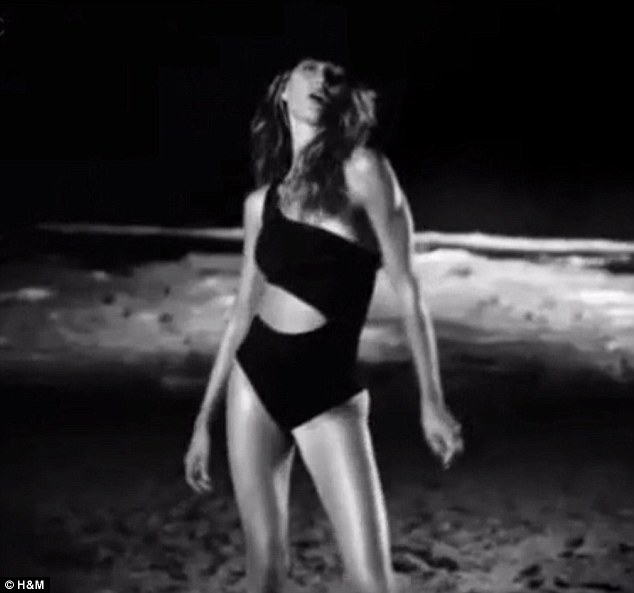 Cutaway girl: The montage cuts to black and white as the supermodel dances in a black swimsuit