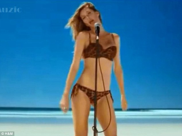 Singing and frolicking: Gisele Bundchen sings a cover of Blondie's Heart Of Glass in new H&M ad campaign