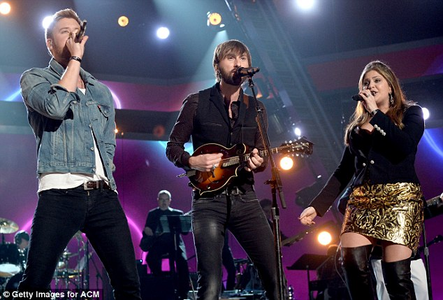 Country stars: Charles, Dave and Hillary are shown performing as Lady Antebellum earlier this month in Las Vegas