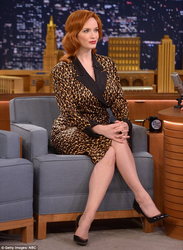 Sitting pretty: Mad Men actress, Christina Hendricks, showcased her curvaceous figure in a silky wrap dress for her appearance on The Tonight Show Starring Jimmy Fallon on Monday night
