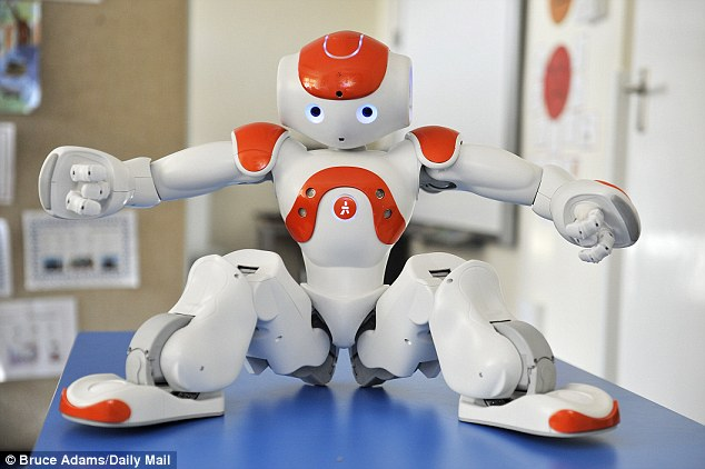 A revolution in the classroom? Max, seen here showing off his Tai Chi skills, is one of two robots donated by the University of Birmingham and Aldebaran to the school