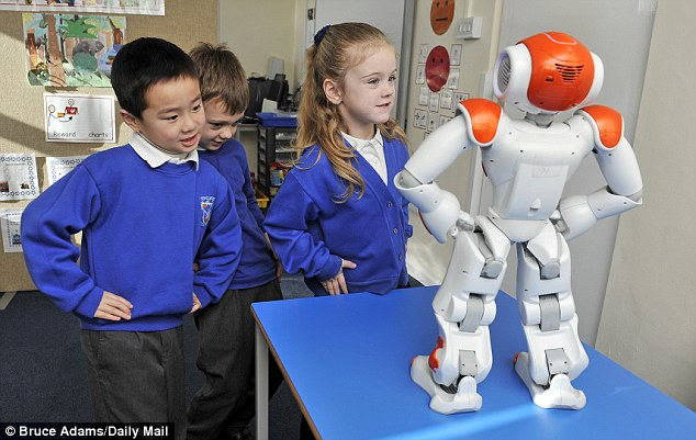 Unlike human teachers, Max and Ben - so named by the pupils - have blank features, no emotions and standardised expressions and responses, which makes the robots much easier for autistic children to relate to and understand. Pictured are Corbin Chow (left), five, James Munro, six, and Libi Cooper, five