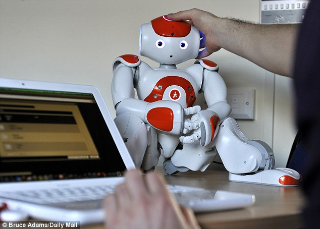 Teachers can communicate through the robot for an entire class by writing sentences into a computer - allowing the children to believe they are being taught by it
