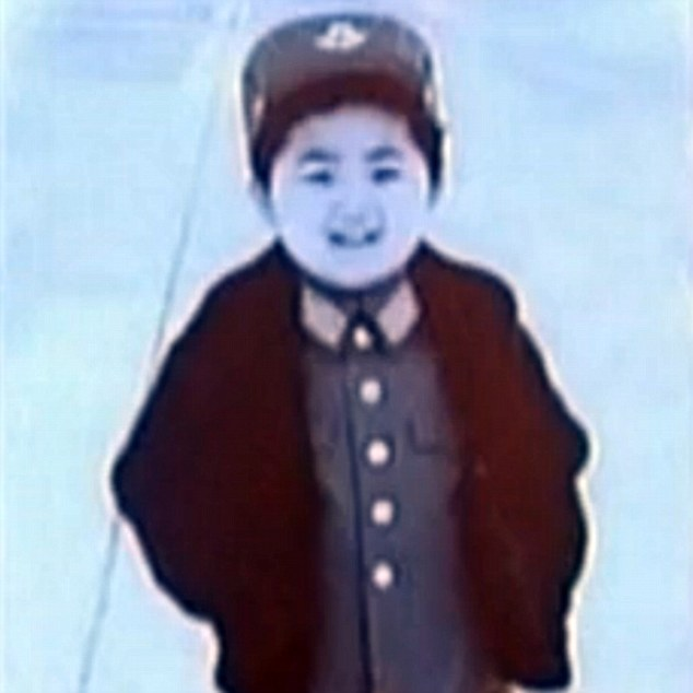 Indoctrinated: Kim Jong-un smiles for the camera while wearing an air force uniform aged about five years old