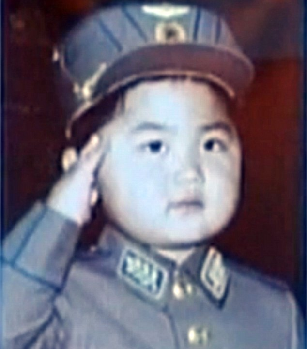 Kim Jong Young: Previously unseen pictures have emerged showing the North Korean leader as a toddler - including this one of him saluting in military uniform