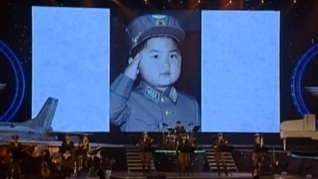 The pictures were displayed on a big screen at a concert where Kim met members of the country's air force