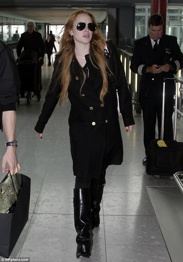 Business trip: Lindsay was spotted catching a flight out of London's Heathrow airport earlier this month