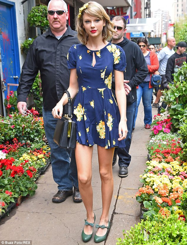 Retail therapy: Taylor spent her afternoon enjoying a shopping trip and looked at flowers in Chelsea