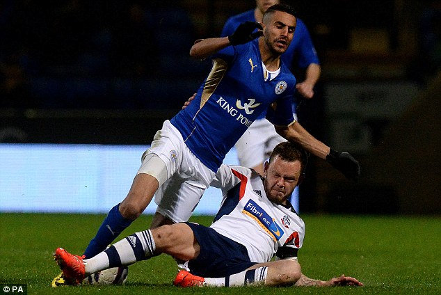 Getting stuck in: Bolton's Jay Spearing tackles Riyad Mahrez of Leicester