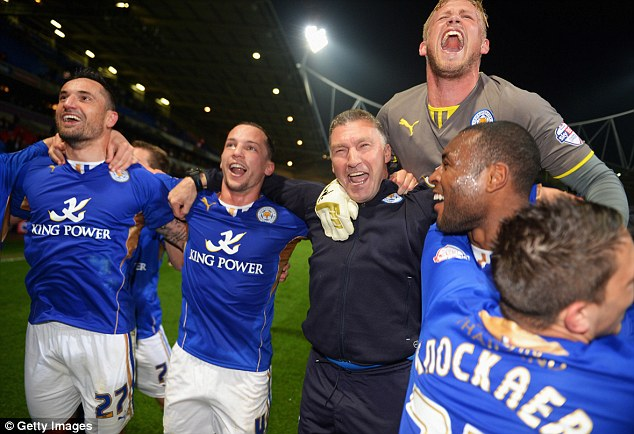 We are the champions! Keeper Kasper Schmeichel jumps on the shoulders of manager Nigel Pearson