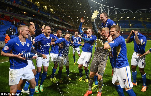 Champagne spray party: Paul Konchesky soaks his team-mates in bubbly after clinching the title