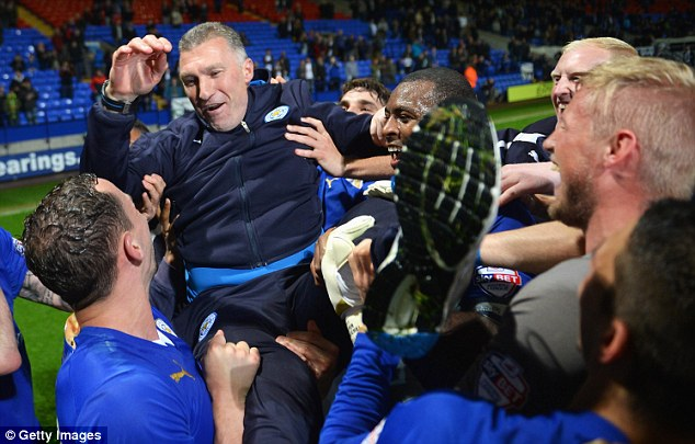 Bumps: Pearson is held aloft by his players after the final whistle