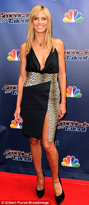 Super style: Looking at least a decade younger than her 40 years, the German born beauty showed off plenty of leg in the black and print dress thanks to a very high split