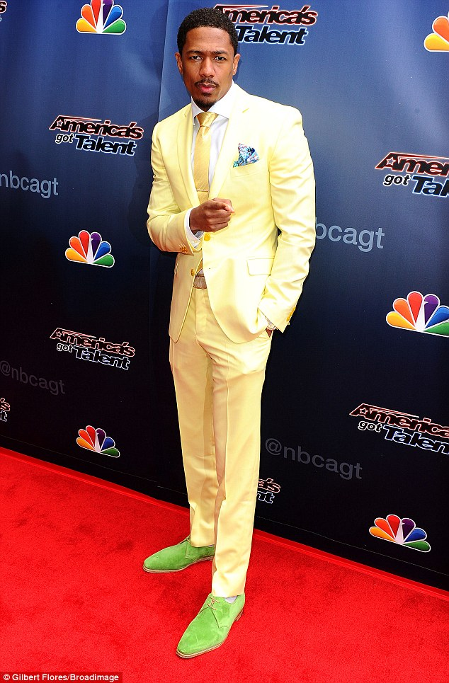 Can't miss him: Nick Cannon made sure to stand out in a bright yellow suit with matching tie and lime shoes