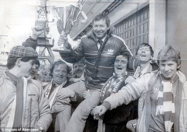 Success: Ferguson holds the European Cup Winners Cup as he is carried by Aberdeen fans