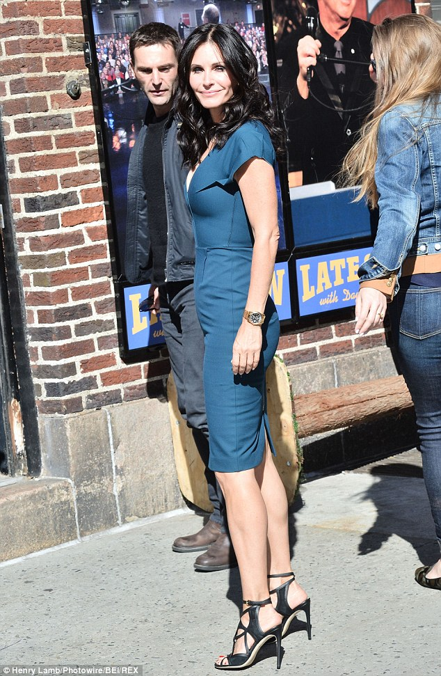 Disappearing ring: Courteney posed next to Johnny, this time with bare hands, outside the Late Show with David Letterman on Monday