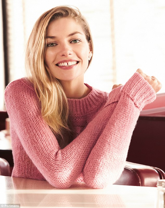 Adorable: Pink was the colour of the shoot; one of the shots saw the blonde beauty flashing her trademark gap-toothed smile in a thick knitted sweater