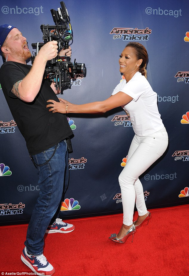 Playful: Melanie was seen getting feisty with one of the camera men