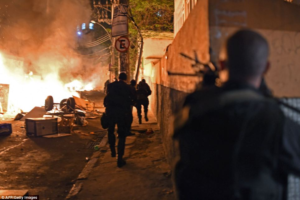 Brazilian Police Special Force members take position during a violent protest in Copacabana, Rio de Janeiro on Tuesday