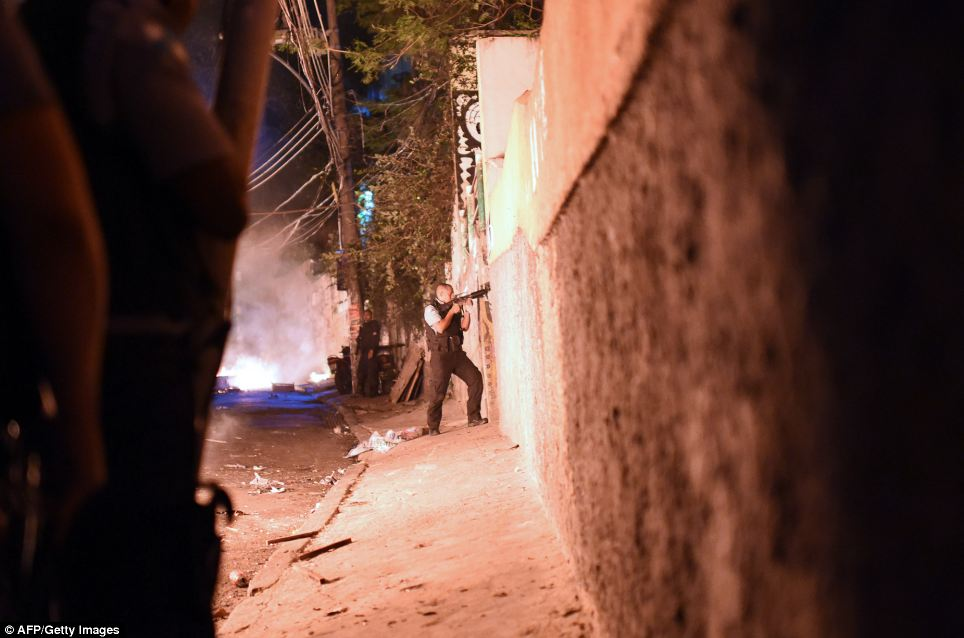 The violence on Tuesday was the latest to hit one of Rio's so-called 'pacified' favelas - impoverished areas that for decades were controlled by drug gangs