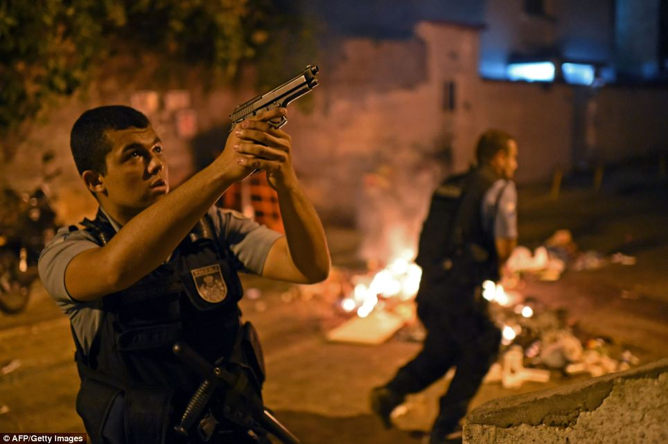 Sharp shooter: Violent protests broke out in Rio's landmark beachfront district, Copacabana, following the death of a resident