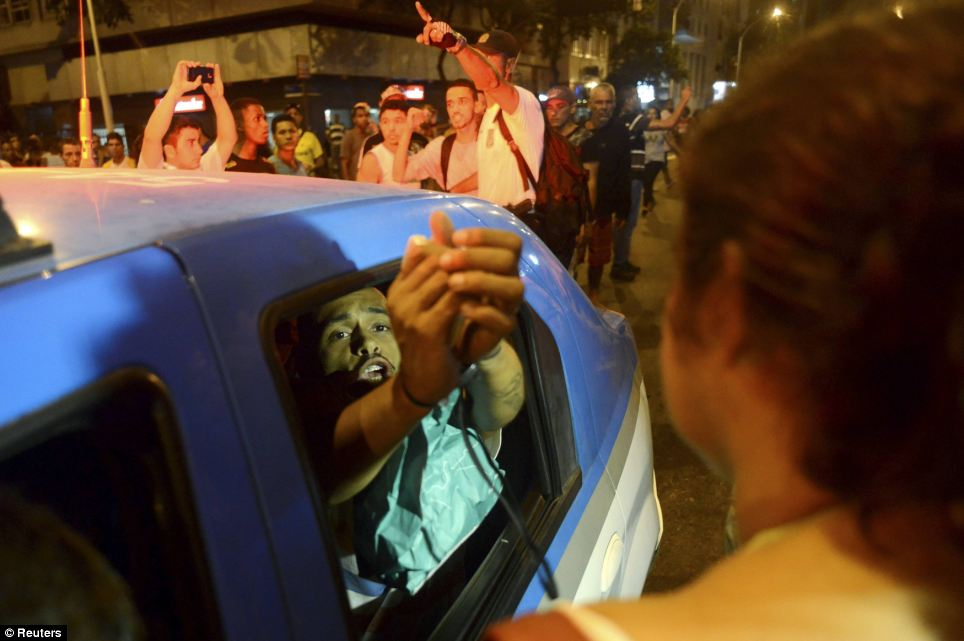 A resident reacts as he is detained by police during a protest against the death of a man in Pavao-Pavaozinho, in the Copacabana neighbourhood in Rio de Janeiro, on Tuesday