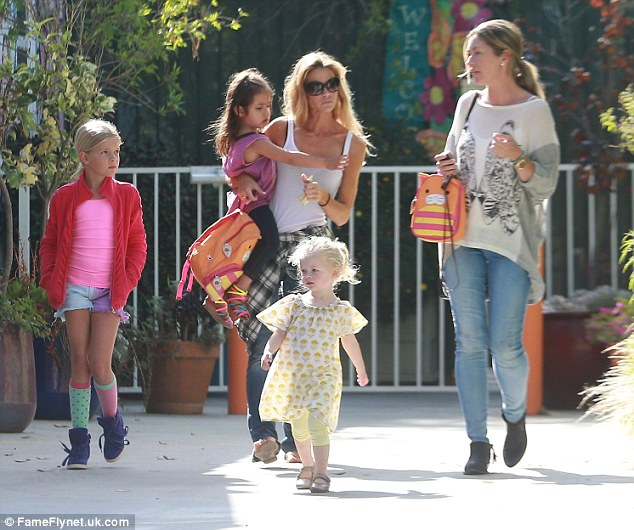 Lovely day: (L-R) Lola, Eloise, their mum Denise, Georgia and her mother Rebecca looked super cute as they stepped out into the sunshine