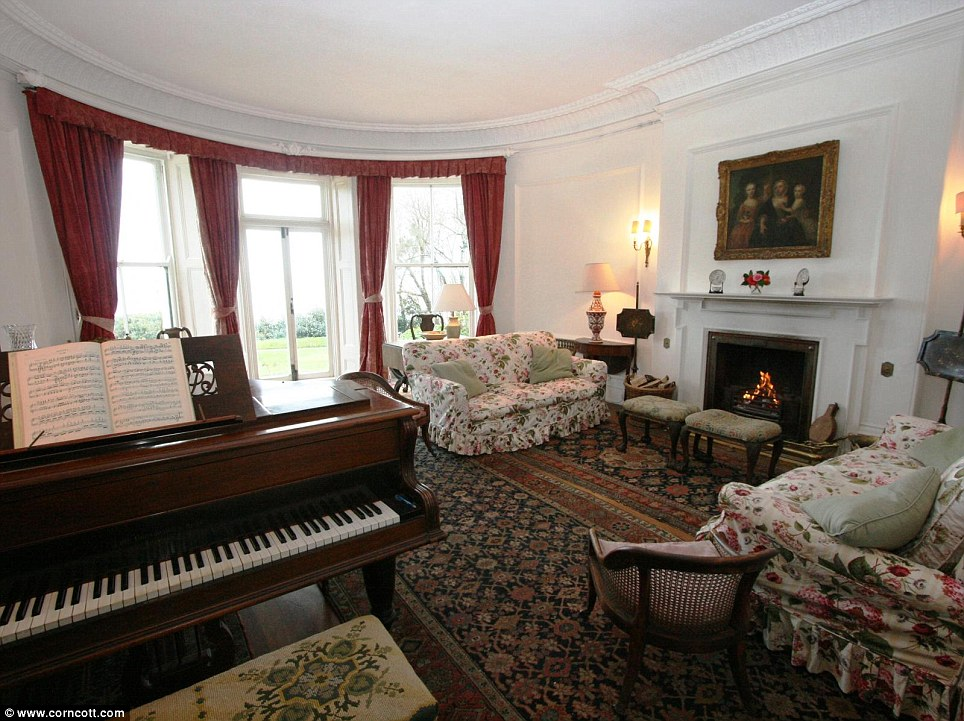 Luxury home: The property, set on 10 acres, boasts three reception rooms - including one with a piano
