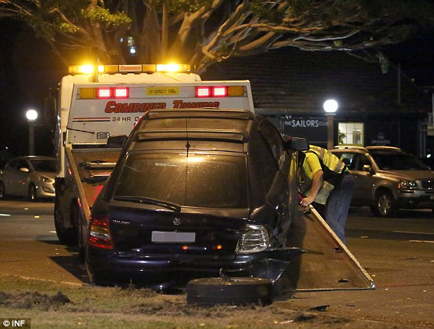 Not drivable: One of the cars hit in the accident is towed from the Rose Bay scene