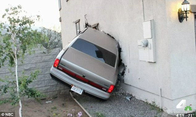 Crash: A family's Los Angeles home has been hit by four cars in the space of just two years - and a crash, pictured, on Easter Sunday nearly struck their baby's crib