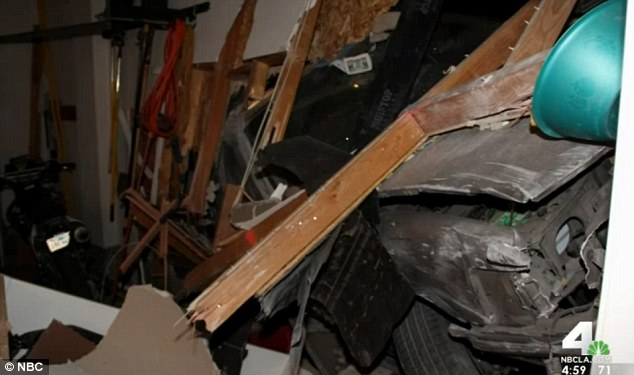 Damage: Jeff Sauerwein is demanding the city of Highland take action to stop speeding drivers on his street after the fourth car slammed through the side of his property around 4a.m. Sunday