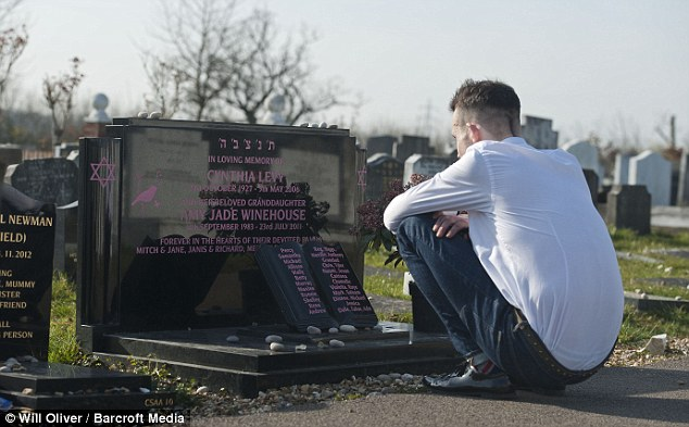 Studying each word: He spent some time at the graveside reading the pink lettering on the grave