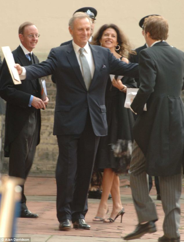 Tender: Mr Shand greets his nephew Tom Parker-Bowles at Major Shand's memorial service