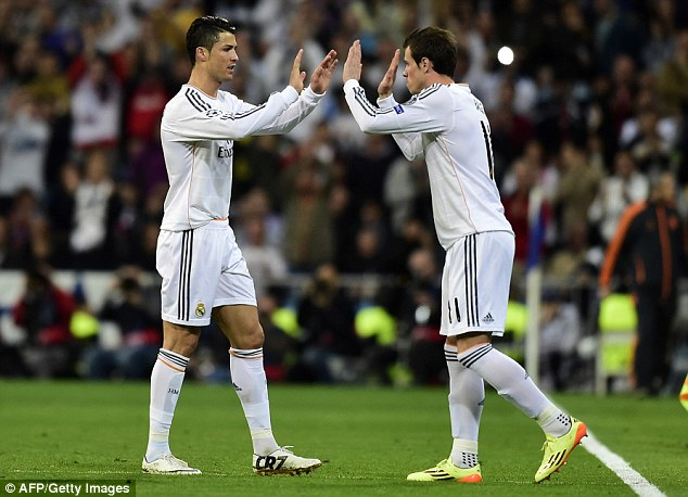High five: Ronaldo is replaced in the 74th minute by Welshman Gareth Bale
