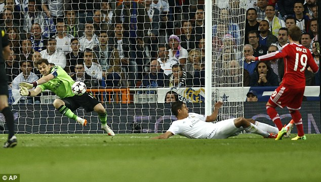 To the rescue: Real Madrid goalkeeper Iker Casillas makes a late save to deny Bayern's Mario Gotze