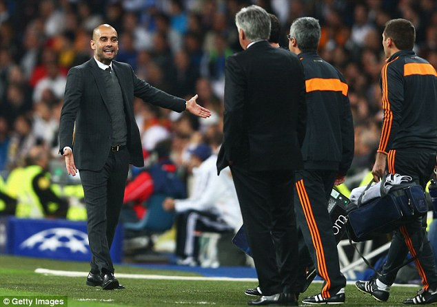 Frustration: Pep Guardiola (left) makes his feelings known as Carlo Ancelotti looks on