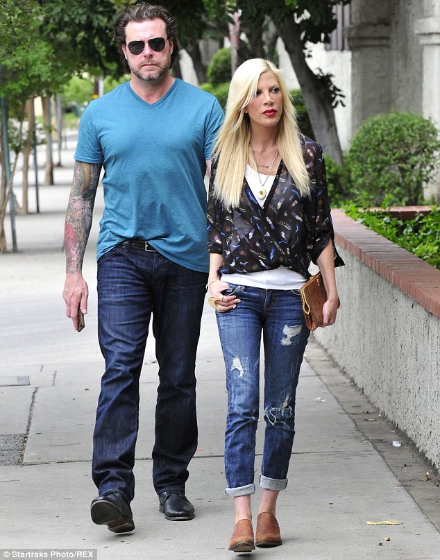 Shocking claims: A source has alleged that Tori Spelling abuses Vicodin and Oxycodone. She is seen with husband Dean McDermott earlier this month