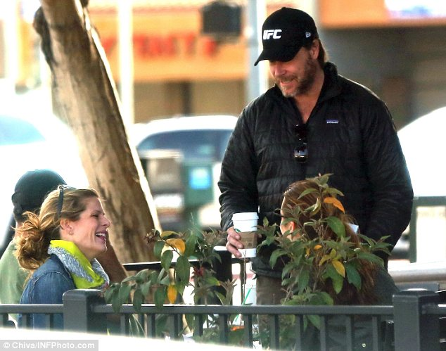 Is that really a good idea?: Dean looked flirty with two women as he picked up coffee in Los Angeles on Wednesday